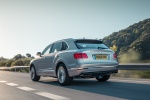 Picture of a driving 2019 Bentley Bentayga in Silver Storm Metallic from a rear left perspective