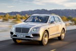 Picture of a driving 2019 Bentley Bentayga in Silver Storm Metallic from a front left perspective