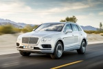 Picture of a driving 2019 Bentley Bentayga in Silver Storm Metallic from a front left three-quarter perspective