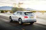 Picture of a driving 2019 Bentley Bentayga in Silver Storm Metallic from a rear left three-quarter perspective