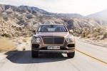 Picture of a driving 2019 Bentley Bentayga in Amber Metallic from a frontal perspective