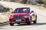 Picture of a driving 2019 Bentley Bentayga in Rubino Red Metallic from a front left perspective