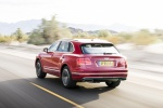 Picture of a driving 2019 Bentley Bentayga in Rubino Red Metallic from a rear left perspective