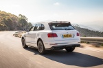 2019 Bentley Bentayga in Glacier White - Driving Rear Left Three-quarter View