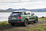 Picture of a 2019 Bentley Bentayga in British Racing Green 4 Metallic from a rear right three-quarter perspective