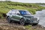 Picture of a 2019 Bentley Bentayga in British Racing Green 4 Metallic from a front right three-quarter perspective