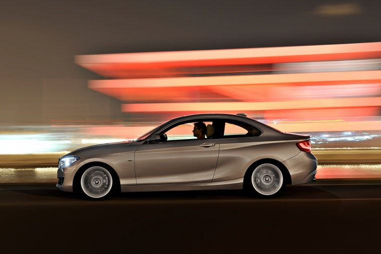 Driving 2017 BMW 2-Series Coupe in Moonlight Silver Metallic from a side view