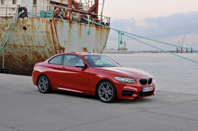 2017 BMW 2-Series M Coupe in Melbourne Red Metallic from a front right three-quarter view