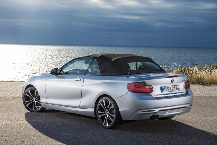 2017 BMW 2-Series Convertible with top closed in Glacier Silver Metallic from a rear left three-quarter view