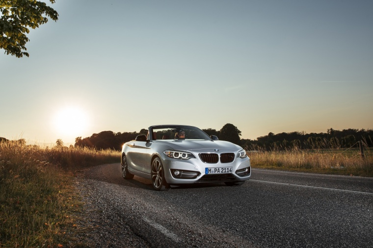 Driving 2017 BMW 2-Series Convertible in Glacier Silver Metallic from a front right view