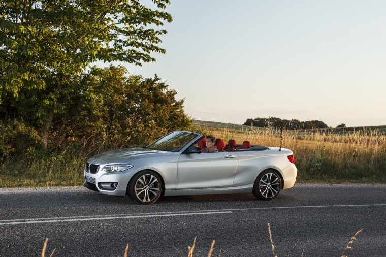 Driving 2017 BMW 2-Series Convertible in Glacier Silver Metallic from a front left three-quarter view