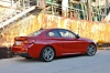 2017 BMW 2-Series M Coupe in Melbourne Red Metallic from a rear right three-quarter view