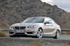 Driving 2017 BMW 2-Series Coupe in Moonlight Silver Metallic from a front left three-quarter view