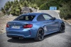 2017 BMW M2 Coupe in Long Beach Blue Metallic from a rear right three-quarter view
