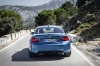 Driving 2017 BMW M2 Coupe in Long Beach Blue Metallic from a rear view