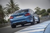 Driving 2017 BMW M2 Coupe in Long Beach Blue Metallic from a rear right view