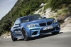 Driving 2017 BMW M2 Coupe in Long Beach Blue Metallic from a front right three-quarter view