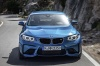 Driving 2017 BMW M2 Coupe in Long Beach Blue Metallic from a frontal view
