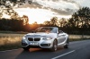Driving 2017 BMW 2-Series Convertible in Glacier Silver Metallic from a front left view