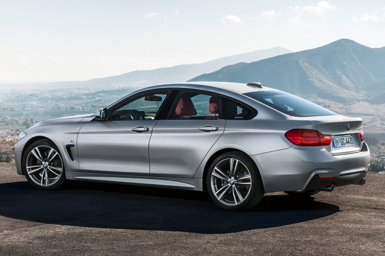 2015 BMW 435i Gran Coupe in Glacier Silver Metallic from a rear left three-quarter view
