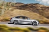 Driving 2015 BMW 435i Gran Coupe in Glacier Silver Metallic from a side view
