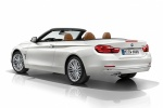 2015 BMW 428i Convertible with open top in Mineral White Metallic - Static Rear Left Three-quarter View