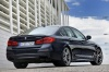 2018 BMW M550i xDrive Sedan in Azurite Black Metallic from a rear right three-quarter view