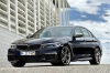 2018 BMW M550i xDrive Sedan in Azurite Black Metallic from a front left three-quarter view