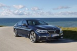2018 BMW M550i xDrive Sedan in Azurite Black Metallic - Driving Front Right View