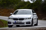 2018 BMW 540i Sedan in Alpine White - Driving Front Left View