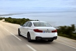 2018 BMW 540i Sedan in Alpine White - Driving Rear Left View