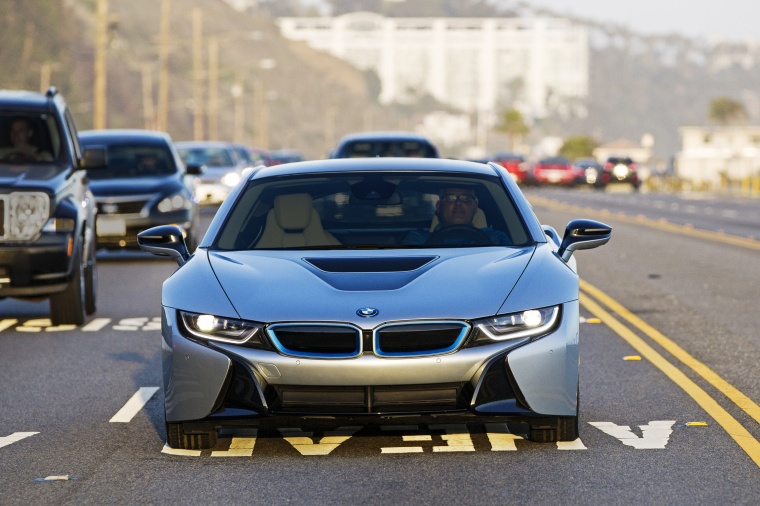 Driving 2016 BMW i8 Coupe in Ionic Silver Metallic from a frontal view