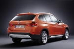 2013 BMW X1 in Valencia Orange Metallic - Static Rear Right Three-quarter View