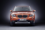 2013 BMW X1 in Valencia Orange Metallic - Static Frontal View