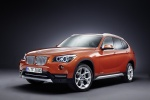 2015 BMW X1 in Valencia Orange Metallic - Static Front Left Three-quarter View