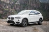 2018 BMW X1 xDrive28i in Alpine White from a front left three-quarter view