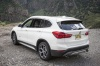 2018 BMW X1 xDrive28i in Alpine White from a rear left view