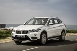 2018 BMW X1 xDrive28i in Alpine White - Driving Front Left Three-quarter View