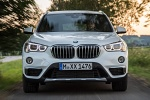 2018 BMW X1 xDrive28i in Alpine White - Driving Frontal View