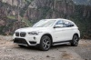 2019 BMW X1 xDrive28i in Alpine White from a front left three-quarter view