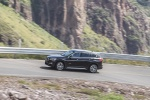 Picture of a driving 2019 BMW X1 xDrive28i in Jet Black from a side perspective