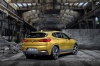 2018 BMW X2 in Galvanic Gold Metallic from a rear right three-quarter view