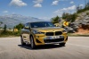 Driving 2018 BMW X2 in Galvanic Gold Metallic from a front right view