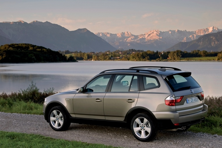2010 BMW X3 xDrive30i in Space Gray Metallic from a rear left three-quarter view