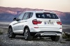 2017 BMW X3 in Mineral White Metallic from a rear left view