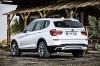 2017 BMW X3 in Mineral White Metallic from a rear left three-quarter view
