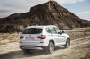 Driving 2017 BMW X3 in Mineral White Metallic from a rear right three-quarter view