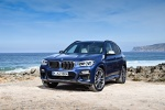 Picture of a 2018 BMW X3 M40i in Phytonic Blue Metallic from a front left perspective