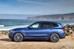 Picture of a 2018 BMW X3 M40i in Phytonic Blue Metallic from a left side perspective