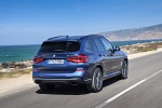 Picture of a driving 2018 BMW X3 M40i in Phytonic Blue Metallic from a rear right perspective